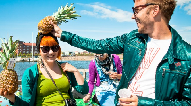 The crew of Restauran Odysseia fools around with pineapples while preparing their restaurant on a carpet washing dock on the first Restaurant Day on 21st of May 2011 in Helsinki, Finland. Photo: Timo Santala
